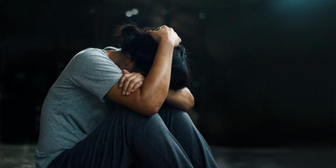 a woman reeling from trauma